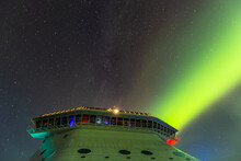 Aurora's Ray Of Green Light Piercing Night Sky Behind A Cruise Ship's Bridge In Alaska. Starry Sky As A Background.