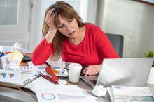 Overworked Businesswoman Sitti...