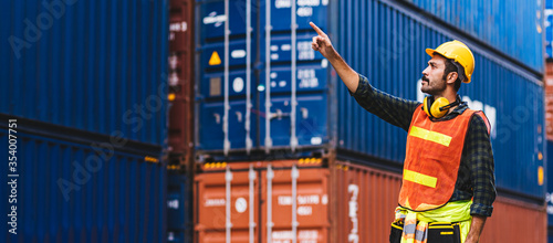 Panoramic smart creative foreman engineer man control loading containers box from cargo freight ship for import export Canvas
