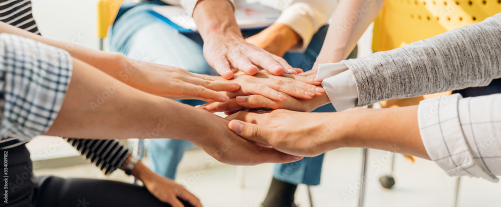 Fototapeta Panoramic teamwork business join hand together concept, Business team standing hands together, Volunteer charity work. People joining for cooperation success business.
