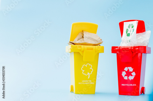 Yellow, green and red recycle bins with recycle symbol on blue background Slika na platnu