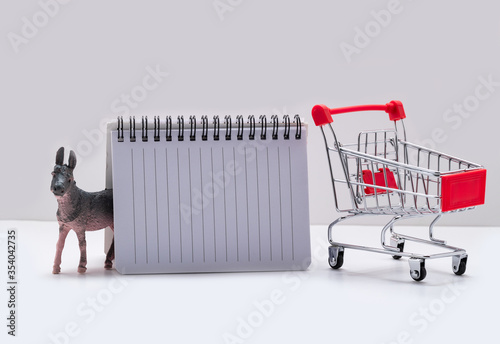 Photo shopping list with donkey and supermarket trolley on a white background