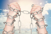 Two Hands Shackled A Metal Cha...