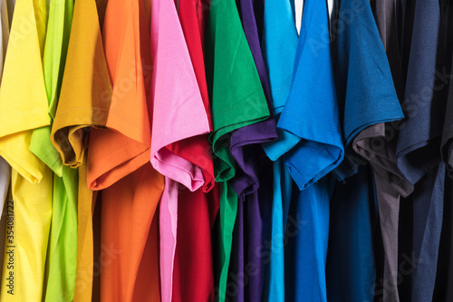 Close Up of t-shirts, Clothes on hangers on white background Fototapet