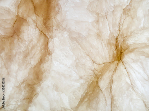 Photo nature alabaster stone have crossed cut to show pattern inside and put light back for interior decoration, show wall in the building