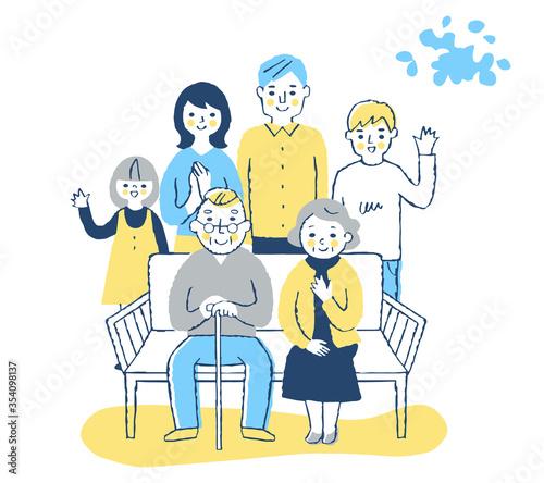 Fototapeta ベンチに座る老夫婦と家族