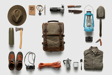 Packing Backpack For A Trip Concept With Traveler Items Isolated On White Background