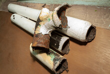 Dismantling Of A Worn-out Dilapidated Sewer Pipe From Cast Iron With An Apartment Building.