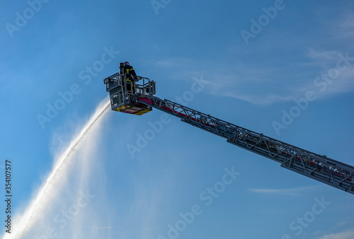 firefighter in action on the large scale Canvas Print