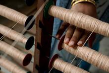 A Handloom Weaver Preparing Ya...