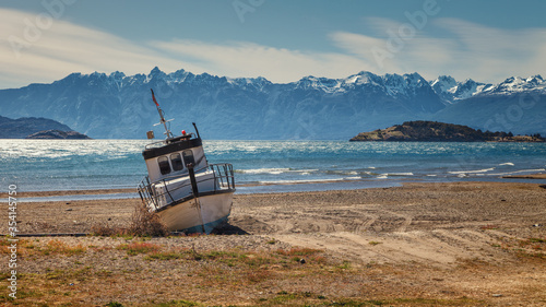 Photo boat aground on the beach of the General Carrera lake, Chilean Patagonia
