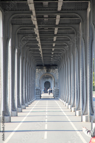 Photo Straight Down the Column Lined Street