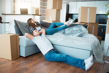 Couple Resting On Couch After ...