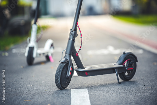 Close up details of electric scooter on the road. Ecological and urban transport in the city