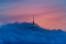 Jested Tower Partly Hidden In The Clouds. Dramatic Evening Atmosphere. Liberec, Czech Republic