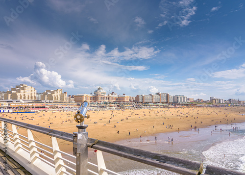 People enjoy themselves on the North Sea beach in Scheveningen with the boulevar Canvas Print