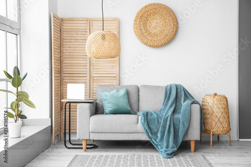 Stylish interior of living room  with sofa Fototapet