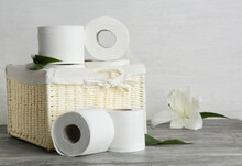 Basket With Toilet Paper On Table