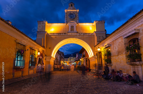 Long exposure at night with unrecognizable people of the Santa Catalina Arch, Antigua, Guatemala Canvas Print