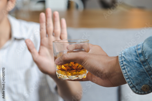 Fotografie, Obraz Stop alcohol concept. Person refuse to drink alcohol.