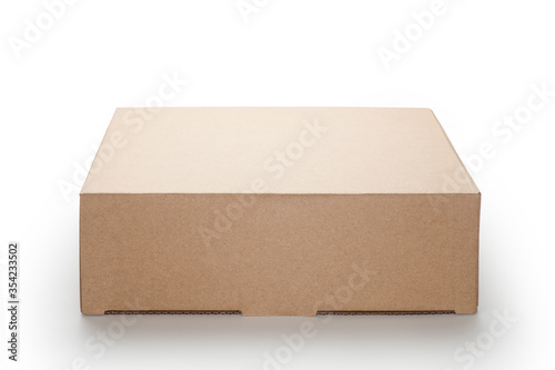 Fotografering Brown cardboard box isolated on white background