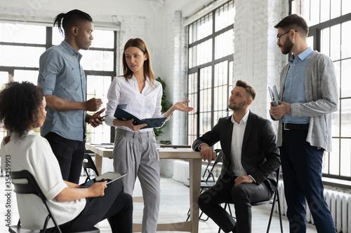 Cuadros en Lienzo Confident businesswoman mentor leading briefing, teaching diverse employees, sta