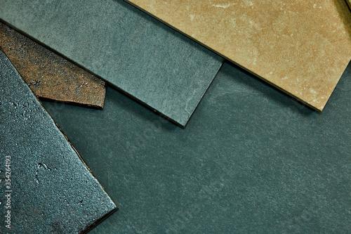 Frame of various different decorative tiles samples on stone background Slika na platnu