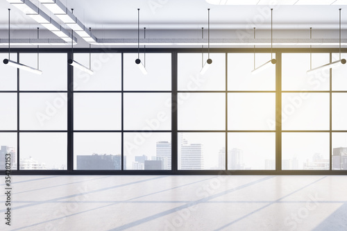 Fototapeta Minimalistic office hall with concrete floor and city view obraz