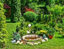 Flower Garden And Artesian Fountain In The Yard