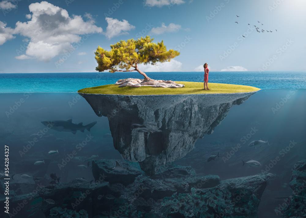 Fototapeta Desolate island with lone girl as freedom concept