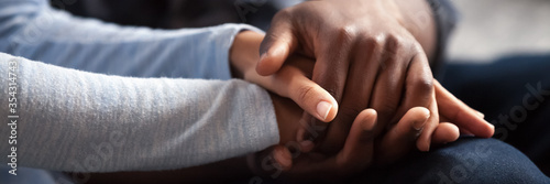 Close up photo african couple in love, woman man holding hands Fototapete