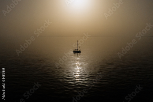 Travel yacht on sea landscape in the sunset early morning with mountain background, Alanya, Antalya, Turkey Canvas Print