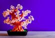 Leinwanddruck Bild - Artificial bonsai tree with natural rose quartz stones. Copy space for text. Conceptual image.