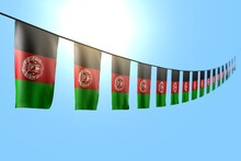 Pretty Many Afghanistan Flags Or Banners Hanging Diagonal On Rope On Blue Sky Background With Selective Focus - Any Occasion Flag 3d Illustration..