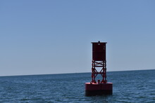Red Buoy On The Ocean