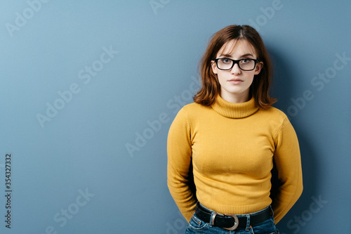 Serious intense young woman wearing eyeglasses Tablou Canvas