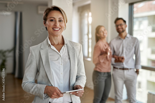 Portrait of happy female real estate agent. Fototapete