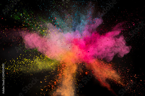 Launched colorful powder on black background, freeze motion