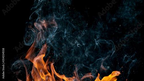 Obraz na plátně fire flames with sparks on a black background, close-up