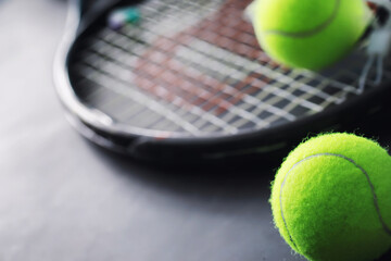 Sport and healthy lifestyle. Tennis. Yellow ball for tennis and a racket on the table. Sports background with tennis concept.