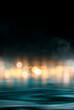 Dramatic dark background. Reflection of light on the water. Smoke fog. Empty futuristic scene. Night water landscape.