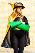 Girl In Super Heroine Costume Posing At Brick Wall