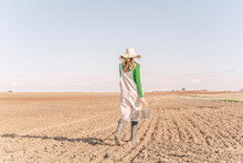 Young Woman Sowing Field For The Future