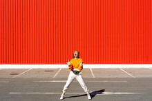 Young Woman Screaming In Front Of A Red Wall