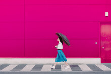 Young Woman With Umbrella Walk...