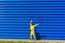 Little Girl Wearing Yellow Tra...
