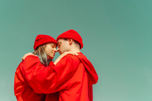 Young Couple Wearing Red Overa...