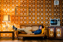Man Lying On Couch In Vintage ...