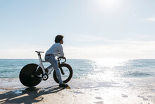 Mid Adult Sitting On His Bike ...
