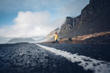 Iceland, Woman Walking On Lane...